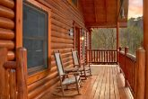 Cabin with 2 decks and rocking chairs