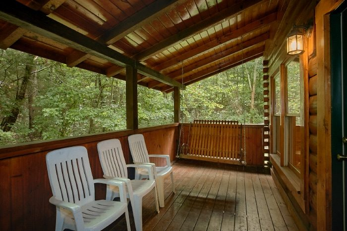 2 Bedroom Cabin that Features a Porch Swing - All Tucked Inn