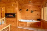 Cabin that Features Fireplace & Indoor Jacuzzi