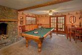 Game Room with Pool Table and Fireplace in Cabin