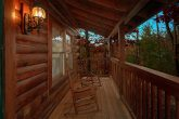 Cabin with Rocking Chairs on Covered Front Porch
