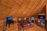 Futon, Arcade Game and Pool Table in Cabin